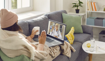 dreamstime xxl 202580320 women on couch telehealth